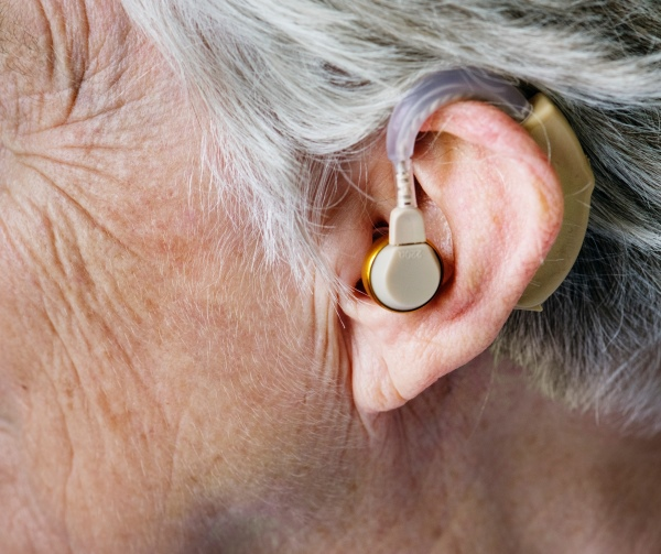 Person wearing a hearing aid