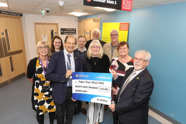 The Oddfellows present a cheque for £28,000 to members of the Lupus Trust research team