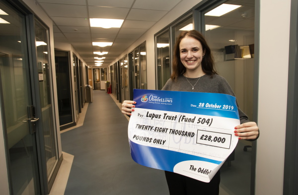 Lupus Trust Research Team PhD student Bekki Velounias with the cheque